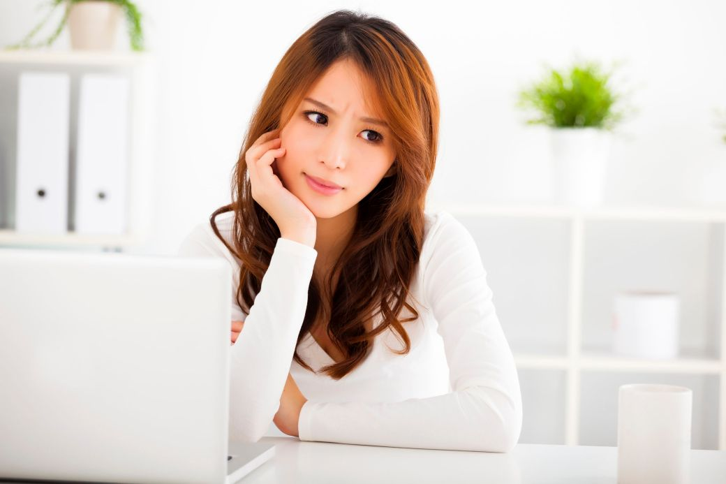 36958794 - stressed young woman with laptop